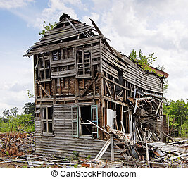 Abandoned Collapsing House - Abandoned collapsing house with...