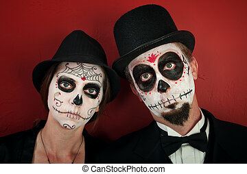 Couple in Skull Makeup - Serious couple in skull and cobweb...