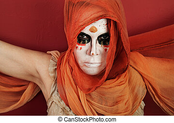 Woman in Facepaint - Woman in an orange scarf and wraith...