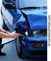 damaged car - expert evaluating damage on a car