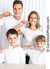 toothbrushing - Happy family toothbrushing Father, mother...