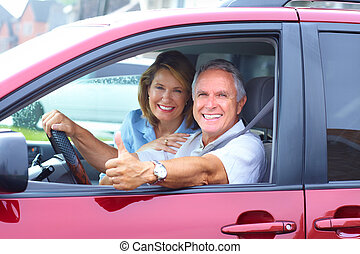 Senior couple in the car - Smiling happy senior couple in...