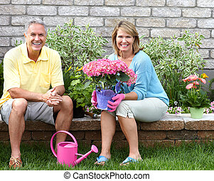 seniors gardening - Smiling happy elderly seniors couple...