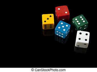 Colorful dices on black background