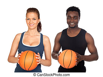 Attractive couple with basketball isolated on a over white...
