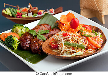 Thai Sausage and Som Tum - A dish of freshly prepared Thai...
