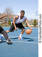 Men Playing Basketball One On One