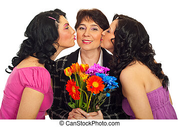 Daughters kissing mother - Two beauty daughters with curly...
