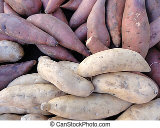 Purple and White Yams for sale - Pile of Purple and White...