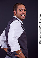 businessman - young happy businessman, on a black background