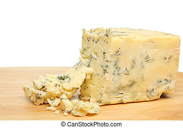 Stilton cheese wedge and crumbs on a board