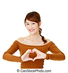 heart - Happy woman make heart shape by her hands, closeup...