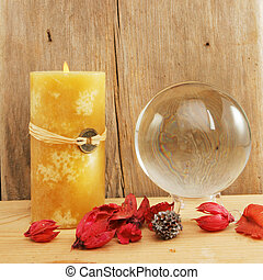 Crystal ball and candle - Crystal ball and a yellow...