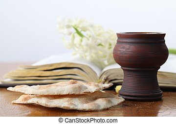 Communion - Chalice with red wine, pita bread, Holy Bible...