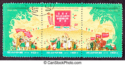 Farmers celebrate the 10th anniversary of Kim Il-Sung?s 1964...