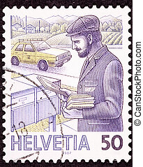 Canceled Swiss Postage Stamp Postman Delivering Mail Box in...