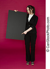 At the bottom - Young business woman holding a black board...