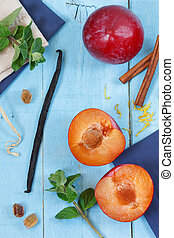 Plums, vanilla and leaves of mint. - Ripe plums, spices and...