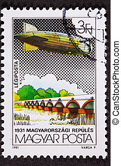 Used Hungarian Postage Stamp Flight, Graf Zeppelin crossing a Bridge or Dam on its historic around the world flight in 1931