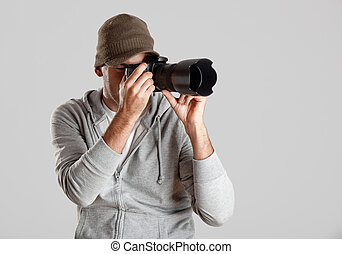 Photographer - Young man posing with a photographic camera...