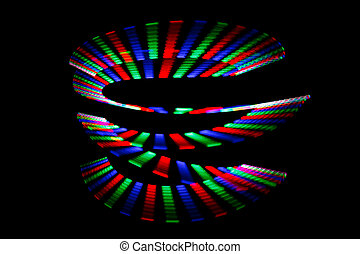 Luminous colors of rainbow trail in form of spiral on black...