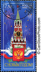 Spassky Tower of Moscow Kremlin and the Russian coat of arms...