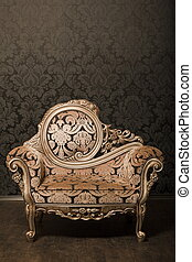 vintage brown-gray chair with gold accents standing beside...