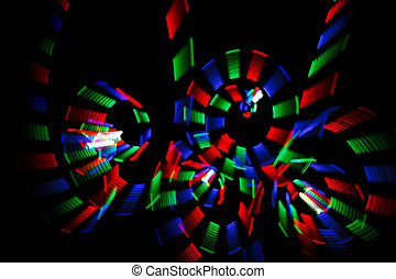 Abstract multicolored freezelight in form of spirals on...