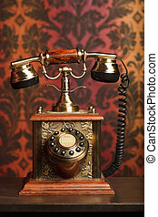 old phone is made of metal on a wooden table. withdrawn...