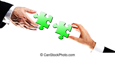 Puzzle pieces assembled by business people