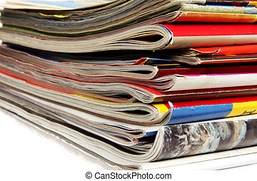Magazines - Stack of colorful magazines on light background