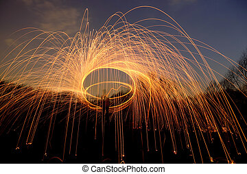 abstract background with orange sparklers flying away at...