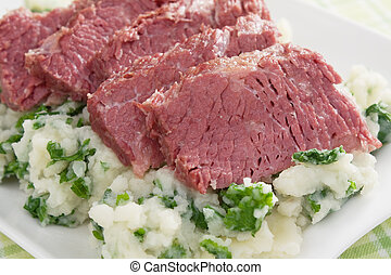 Colcannon and Corned Beef - Slices of corned beef on top of...