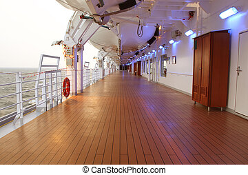cruise ship deck with wooden brown floor and turned on lamps...