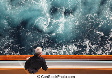 man standing at cruise ship deck and looking at side view...