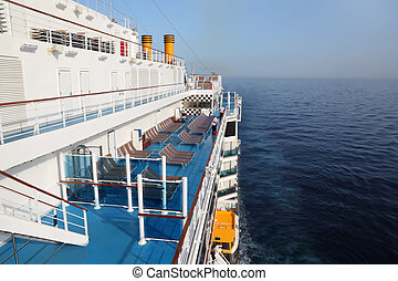 cruise ship deck with blue floor in ocean view from above