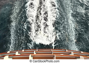 ship deck and trail with waves and foam in ocean view from...