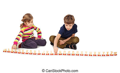 little boy and girl playing with wooden railway sitting on floor, full body, train in line, isolated on white