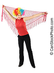 young attractive woman in clown wig standing and holding red shawl, isolated on white