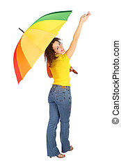 young beauty woman in yellow shirt with multicolored umbrella standing with reached out a hand isolated on white, view from back