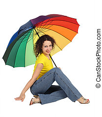 young attractive woman in yellow shirt with multicolored umbrella sitting isolated on white looking at camera