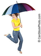 young beauty woman in yellow shirt with multicolored umbrella jumping isolated on white