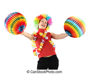 young beauty woman in clown wig, flower garland and multicolored decorative balls, laughing and looking at camera, half body