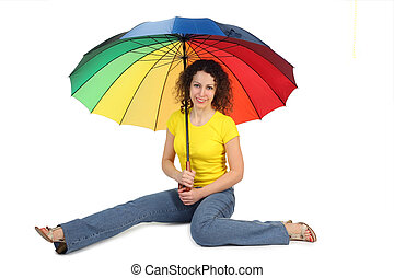 young attractive woman in yellow shirt with multicolored umbrella sitting isolated on white legs at sides