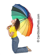 young attractive woman in yellow shirt with multicolored umbrella sitting isolated on white and looking up side view