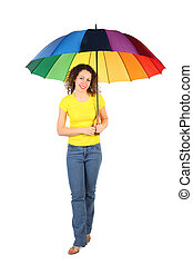 young beauty woman in yellow shirt with multicolored umbrella standing crossed legs isolated on white