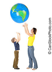 mother and son throw up big inflatable globe, side view,...