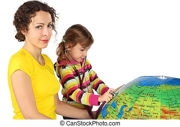 mother and little girl with stethoscope and big inflatable globe, focus on mother