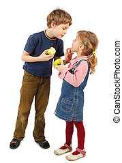 little boy standing and looking into girl's mouth, children holding apples, isolated on white
