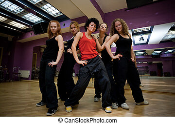 training dancing collective in show room before statement